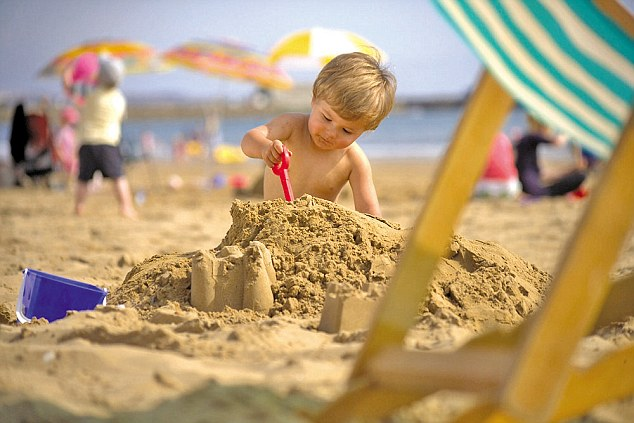 Kid building sandcastles with your kids