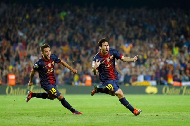 Barcelona's Lionel Messi from Argentina, right, celebrates after scoring a goal against Real Madrid's followed by team mate Jordi Alba during a Spanish La Liga soccer match at the Camp Nou Stadium, in Barcelona, Sunday, Oct. 7, 2012. (AP Photo/Daniel Ochoa De Olza)